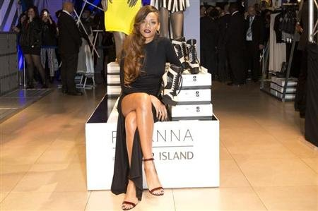 "Singer Rihanna attends the launch of her collection ""Rihanna for River Island"" at a store in central London March 4, 2013. REUTERS/Neil Hall"