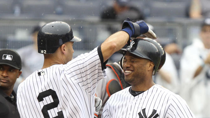 New York Yankees' Robinson Cano, right, is greeted by Derek Jeter after hitting a grand slam during the third inning of a baseball game against the Baltimore Orioles, Wednesday, Aug. 1, 2012, at Yankee Stadium in New York. (AP Photo/Seth Wenig)