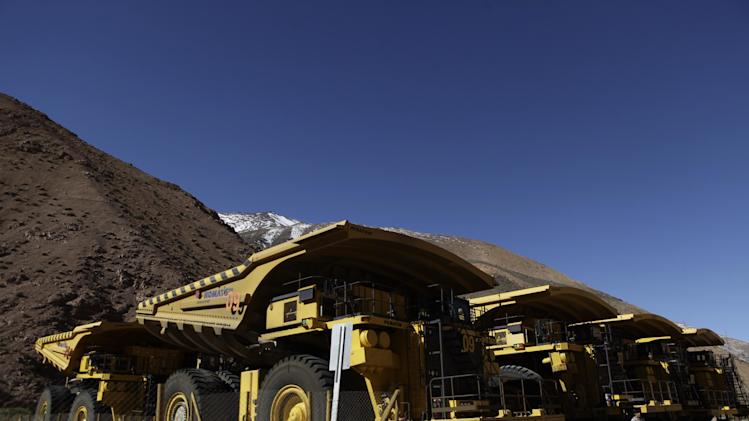 In this May 23, 2013 photo, mining trucks sit parked on the facilities at the Barrick Gold Corp's Pascua-Lama project facilities in northern Chile. Chile's newly empowered environmental regulator confirmed nearly two-dozen violations of Barrick's environmental impact agreement on Friday, May 24, 2013, blocking all other construction on the $8.5 billion project until the Canadian company keeps its promises to prevent water contamination. (AP Photo/Jorge Saenz)
