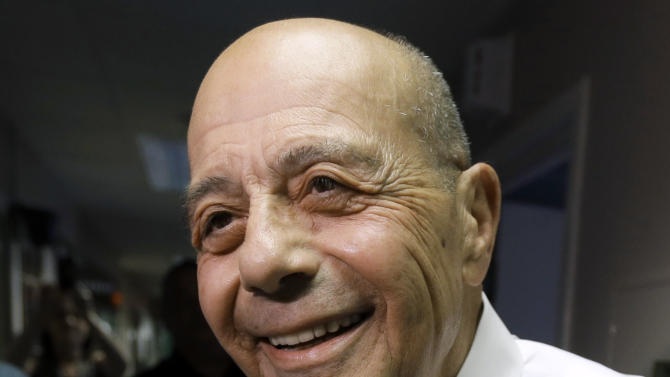 FILE - In this Wednesday, June 25, 2014 file photo, former ProvidenceMayor Buddy Cianci speaks with reporters at the WPRO-AM radio station in East Providence, R.I., after announcing on the air that he will run for a seventh term as mayor. Cianci was forced to resign in 1984 after he was convicted of assault. In 1990 he won his job back until he was convicted of racketeering conspiracy in 2002 and sent to prison as part of a federal investigation into corruption in City Hall. (AP Photo/Steven Senne, File)