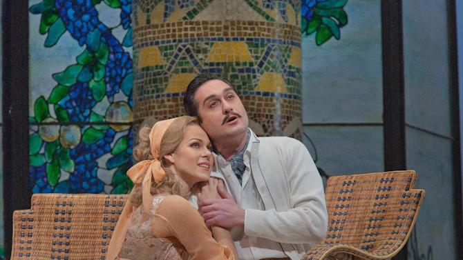 "This January 8, 2013 photo provided by the Metropolitan Opera shows Kristine Opolais as Magda and Giuseppe Filianoti as Ruggero in a dress rehearsal of Puccini's ""La Rondine"" at he Metropolitan Opera in New York. (AP Photo/Metropolitan Opera, Ken Howard)"