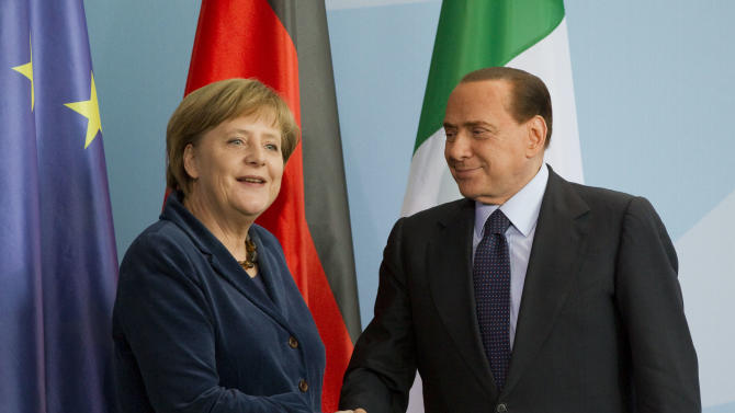 FILE- This is a Wednesday, Jan. 12, 2011 file photo of German Chancellor Angela Merkel, left, and Italian Prime Minister Silvio Berlusconi, right, as they shake hands after a news conference at the chancellery in Berlin, Germany. Often these days, the first order of business at European Union summits is not the continent's dreadful financial crisis. It's getting to know the people around the table. The group of national leaders that will meet this week in Brussels is a different crew from the one that met in October 2009, when the crisis in Europe first erupted with the news that Greece was in deep difficulty.  (AP Photo/Gero Breloer, File)