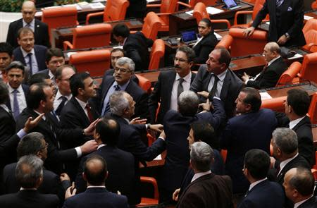 Members of parliament from the ruling AKP and CHP scuffle during a debate at the parliament on draft budget in Ankara