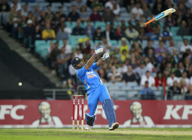 India's Dhoni loses control of his bat during a T20 cricket match against Australia in Sydney
