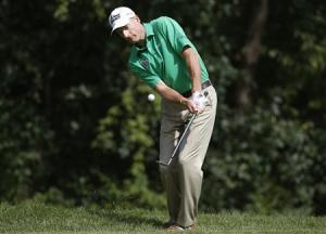 Furyk of U.S. chips on the sixth hole during the third round of the BMW Championship golf tournament at the Conway Farms Golf Club in Lake Forest, Illinois