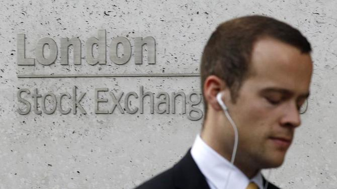 A pedestrian walks past the London Stock Exchange