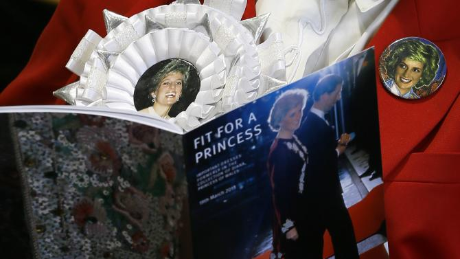 Diana fan Margaret Tyler reads a catalogue ahead of the Kerry Taylor 'Fit for a Princess' auction in London, Tuesday, March 19, 2013. The auction was of ten dresses formerly owned and worn by Britain's Princess Diana. The total hammer price for the ten lots was 719,000 pounds ($1.09 million US) not including the 20 percent buyers premium . (AP Photo/Kirsty Wigglesworth)