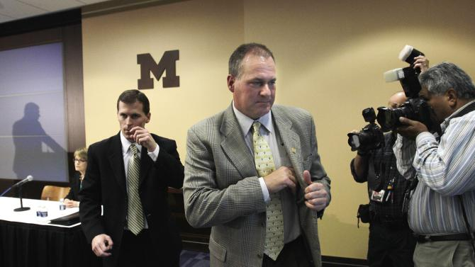 Michigan head football coach Rich Rodriguez leaves a news conference in Ann Arbor, Mich., Thursday, Nov. 4, 2010 after addressing the media on NCAA violation infractions. The NCAA on Thursday handed Michigan a third year of probation for practice and training violations, declining to sharply punish Rodriguez or his program for an embarrassing problem that cropped up just a few days before last season. (AP Photo/Carlos Osorio)