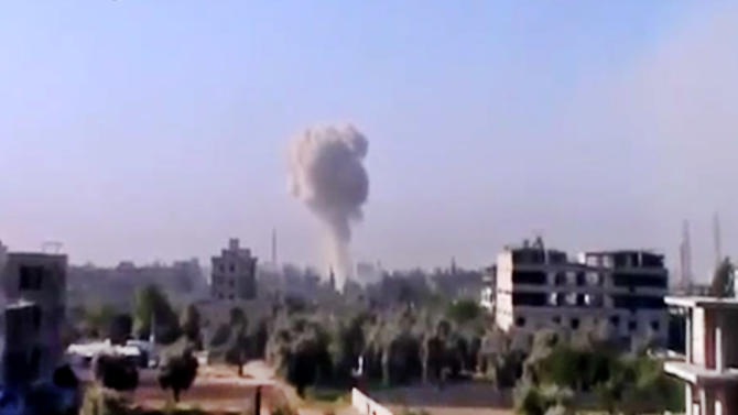 In this image taken from video obtained from the Ugarit News, which has been authenticated based on its contents and other AP reporting, smoke rises due to heavy shelling in Arbeen, Damascus countryside, Syria, on Monday, April 29, 2013. (AP Photo/Ugarit News via AP video)