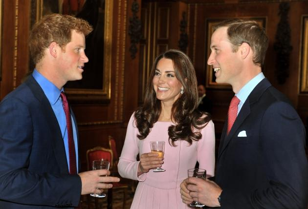 Catherine, Duchess of Cambridge and Prince William, Duke of Cambridge speak to Prince Harry during a reception at Windsor Castle in Windsor, England Catherine, Duchess of Cambridge and Prince William, Duke of Cambridge speak to Prince Harry during a reception in the Waterloo Chamber, before the Lunch For Sovereign Monarchs at Windsor Castle, on May 18, 2012  -- Getty Premium
