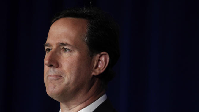 Republican presidential candidate, former Pennsylvania Sen. Rick Santorum pauses while speaking at the Faith and Freedom Coalition Presidential Kick-Off in Pewaukee, Wis., Saturday, March 31, 2012. (AP Photo/Jae C. Hong)