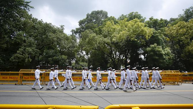 Indian soldiers march before the arrival of the body of former Indian President Kalam, outside his residence in New Delhi