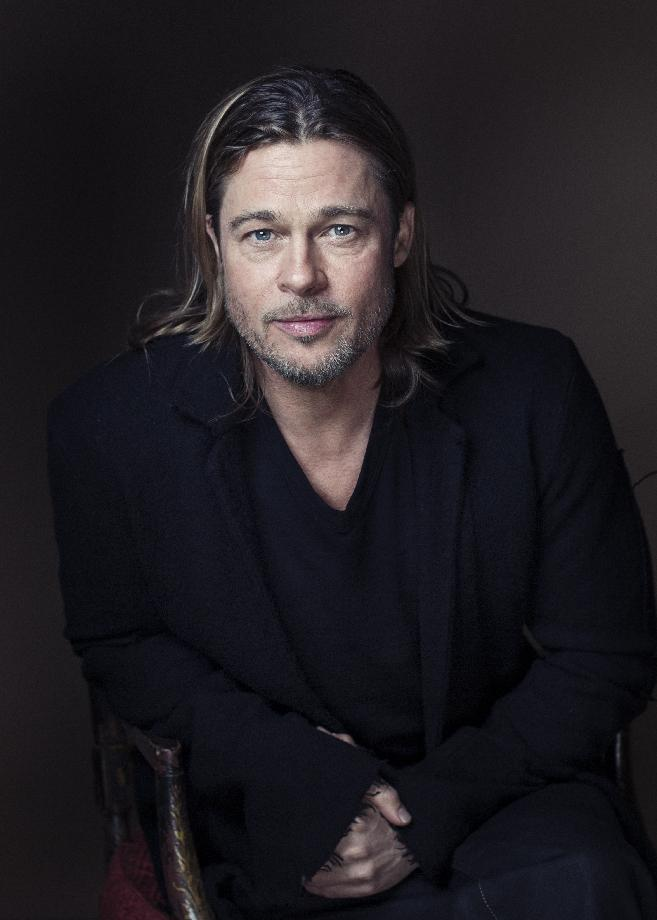 "FILE - This Nov. 26, 2012 file photo shows Brad Pitt posing for a portrait in New York. Pitt stars in ""World War Z,"" opening on Friday, June 21, 2013. (Photo by Victoria Will/Invision/AP, file)"