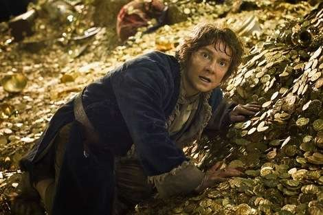 The Hobbit: No picture more accurately represents what 'Desolation of Smaug's box office performance is like than Bilbo Baggins on a pile of gold.