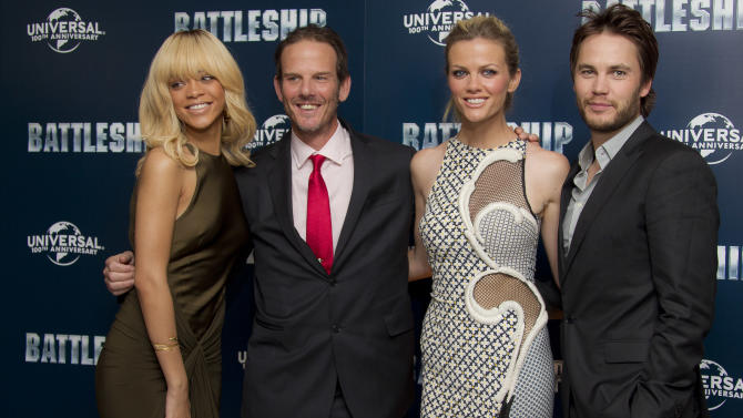 Rihanna, left, director Peter Berg, second left, Brooklyn Decker and Taylor Kitsch, right, pose for photographers at a central London hotel during a photocall for their film 'Battleship', Wednesday, March 28, 2012. (AP Photo/Joel Ryan)