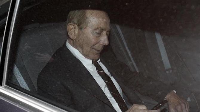 Former CEO of American International Group Inc, Greenberg, checks his phone inside a car after leaving a building in Downtown New York where he was deposed by the Attorney General's office