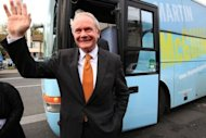 <p>Sinn Fein presidential candidate Martin McGuinness canvasses in Dublin in October 2011. Queen Elizabeth II made a historic gesture in Northern Ireland's peace process when she shook hands with McGuinness -- a former IRA commander.</p>