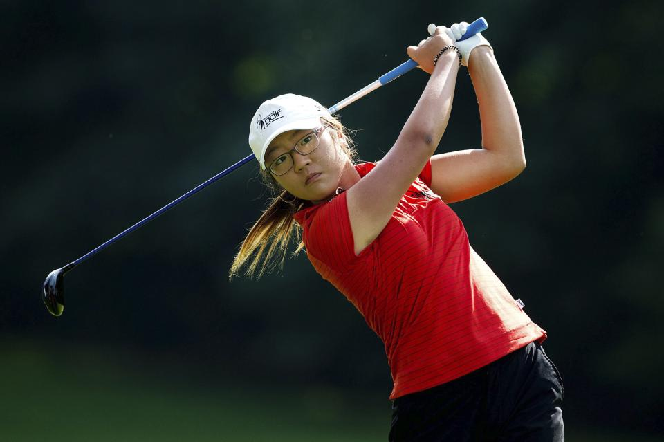 Lydia Ko, of New Zealand, hits her second shot on the sixth hole during the final round of the LPGA Tour's Canadian Women's Open golf tournament, Sunday, Aug. 26, 2012, at the Vancouver Golf Club in Coquitlam, British Columbia. (AP Photo/The Canadian Press, Darryl Dyck)