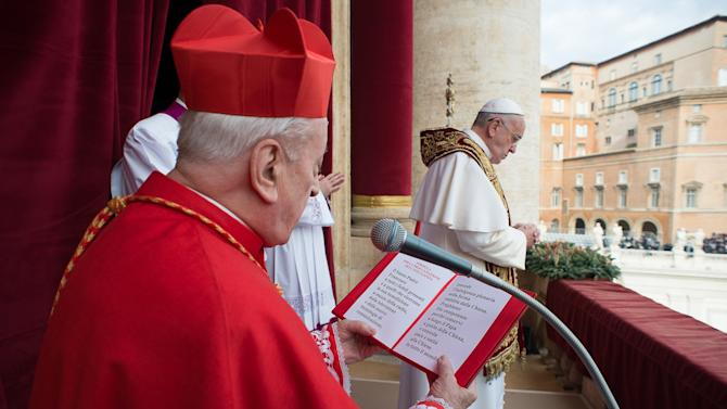 "Pope Francis delivers a ""Urbi et Orbi"" (to the city and world) message from the balcony overlooking St. Peter's Square at the Vatican"