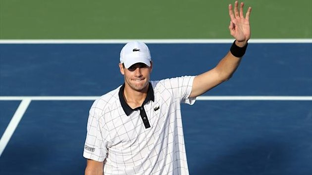 John Isner celebrates after defeating Jo-Wilfried Tsonga in the semi-finals of the Winston-Salem Open (AFP)
