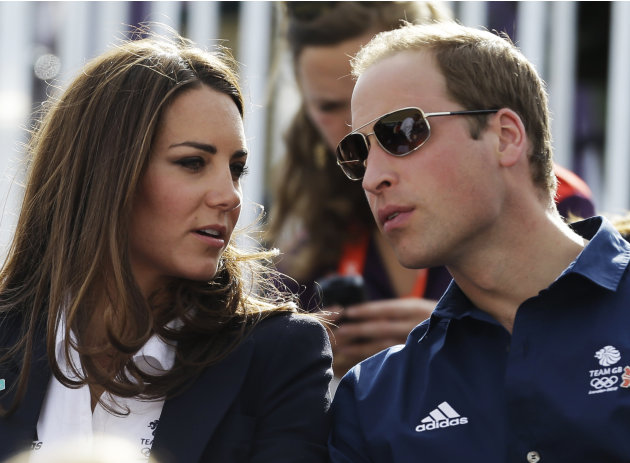 Britain's Catherine, Duchess of Cambridge, and Britain's Prince William, the Duke of Cambridge, watch the equestrian eventing cross country phase at the 2012 Summer Olympics, Monday, July 30, 2012, in