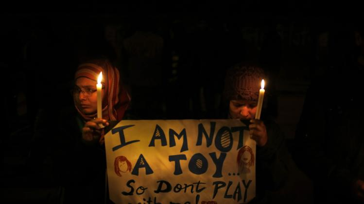 Indians hold a candle light vigil to salute the undying spirit of a rape victim as well as urge the government to make several key reforms to ensure safety of women, in New Delhi, India , Sunday, Dec. 30, 2012. The young woman who died after being gang-raped and beaten on a bus in India's capital was cremated Sunday amid an outpouring of anger and grief by millions across the country demanding greater protection for women from sexual violence. (AP Photo/ Saurabh Das)