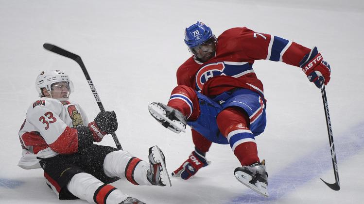 Ottawa Senators' Jakob Silfverberg (33) collides with Montreal Canadiens' P.K Subban during the third period of Game 5 first-round NHL hockey Stanley Cup playoff series in Montreal, Thursday, May 9, 2013. (AP Photo/The Canadian Press, Graham Hughes)