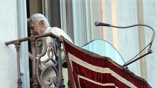 Pope Benedict XVI leaves after greeting the faithful from the balcony window of the papal  summer residence of Castel Gandolfo, the scenic town where he will spend his first post-Vatican days and made his last public blessing as pope,Thursday, Feb. 28, 2013. (AP Photo/Alessandra Tarantino)