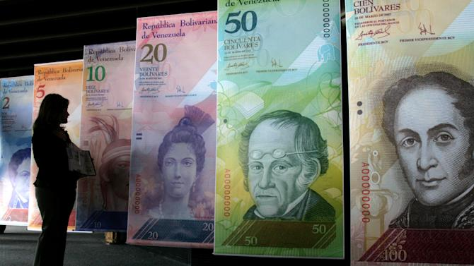 Venezuela devalues currency amid dollar shortage