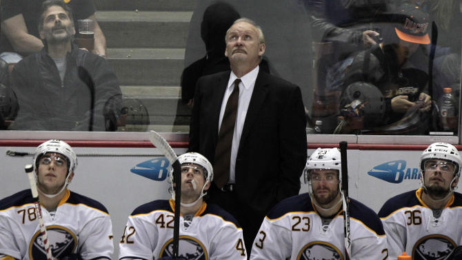 FILE - In this Feb. 29, 2012, file photo, Buffalo Sabres head coach Lindy Ruff looks up behind his bench while playing the Anaheim Ducks during the third period of an NHL hockey game in Anaheim, Calif. Ruff was fired on Wednesday, Feb. 20, 2013, after the team's latest slow start to the season and amid growing criticism from the team's fan base.(AP Photo/Gregory Bull, File)