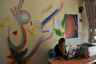 Sahar Gul&#39;s Netcafe manager Tooba Ahmadyar uses her computer at Kabul&#39;s Young Women For Change, Afghanistan&#39;s first women-only Internet cafe. Ten years after the fall of the Taliban, the use of social media in Afghanistan is booming as people rush to get their message across