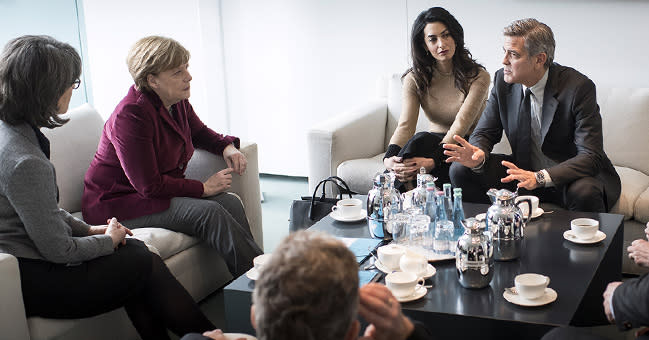 George and Amal Clooney Discuss Refugee Crisis With Angela Merkel