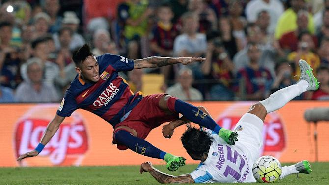 Barcelona's Brazilian forward Neymar da Silva Santos Junior (L) falls as he vies with Malaga's defender Argentinian Marcos Alberto Angeleri during the Spanish league football match at the Camp Nou stadium in Barcelona on August 29, 2015