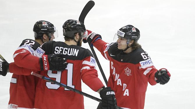 Canada's Tyler Seguin, center, celebrates with team mates scoring against the Czech Republic during the Hockey World Championships Group A match in Prague, Czech Republic, Monday, May 4, 2015. (AP Photo/Petr David Josek)