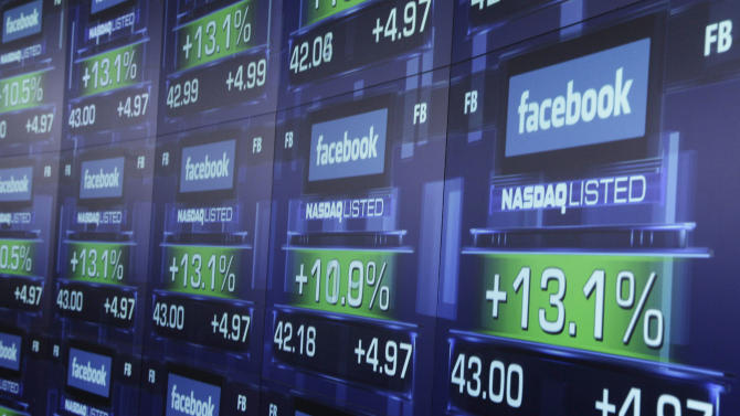 """FILE - In this Friday, May 18, 2012 file photo, electronic screens show the price of Facebook shares after they began trading in New York. A flood of analyst reports from the banks that led Facebook's initial public offering gave the company's stock a mix of """"Neutral"""" and """"Buy"""" ratings on Wednesday, June 27, 2012 The day marks the end of a 40-day quiet period following the IPO, during which the underwriters aren't allowed to issue ratings. (AP Photo/Richard Drew)"""