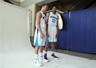 New Orleans Hornets basketball players Austin Rivers, left and Anthony Davis pose in uniform in New Orleans, Friday, June 29, 2012. Davis was the first pick in the 2012 NBA Draft Thursday night. Rivers was the 10th pick of the first round. (AP Photo/Kerry Maloney)