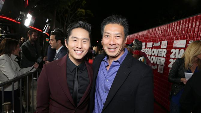 """Justin Chon and Francois Chau arrive at the LA premiere of """"21 and Over"""" at the Westwood Village Theatre on Thursday, Feb. 21, 2013 in Los Angeles. (Photo by Eric Charbonneau/Invision/AP)"""