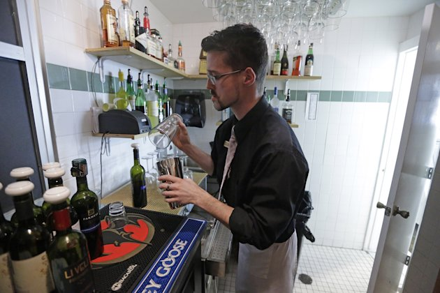 "<p>               Manager Dustin Humes fixes a drink in a small room which is out of the view of patrons at Vivace Restaurant Monday, Feb. 26, 2013, in Salt Lake City. Utah lawmakers are considering repealing a law that requires restaurants to mix alcoholic drinks out of view from patrons. Commonly known as ""Zion curtains,"" the mandate went into effect for restaurants in 2010 as part of a compromise when lawmakers lifted a mandate for bars to operate as members-only social clubs. The rule does not apply to restaurants that opened before 2010. A House committee is expected to discuss the bill Wednesday. Restaurant owners and tourism officials say the law is unnecessary and hinders tourism. But some lawmakers say that removing the mandate could encourage underage drinking and influence customers to drink too much. (AP Photo/Rick Bowmer)"