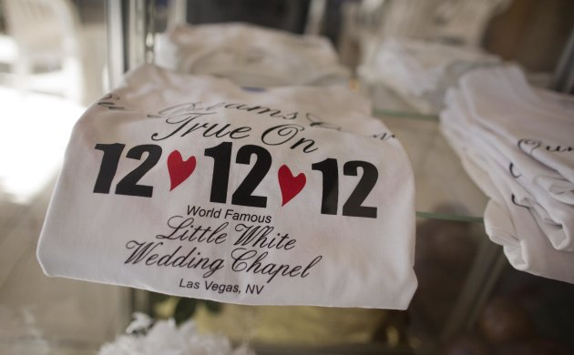 "Tee shirts advertising the 12-12-12 date sit on display at A Little White Wedding Chapel, Tuesday, Dec. 11, 2012, in Las Vegas. These ""once-in-a-century"" wedding dates have become more important each"