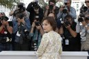 Actress Kristin Scott Thomas poses for photographers during a photo call for the film Only God Forgives at the 66th international film festival, in Cannes, southern France, Wednesday, May 22, 2013. (AP Photo/Lionel Cironneau)