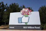 "A Facebook ""like"" button logo with flowers is seen at the entrance of the Facebook headquarters in Menlo Park, California, on May 11, 2012. Membership in Facebook's social network won't help small investors buy shares in the upcoming IPO, no matter how much you ""like"" the company"