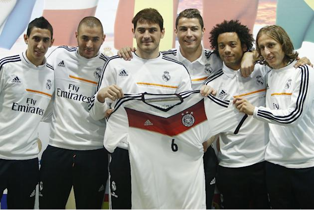 Real Madrid's Cristiano Ronaldo from Portugal centre right, Iker Casillas, centre left, Angel Di Maria from Argentina, left, Karim Benzema from France, second left, Marcelo from Brazil, second rig