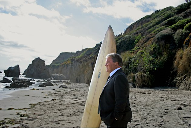 This image released by Priceline.com shows William Shatner on a beach during a commercial for Priceline.com. Seven months after a commercial showed Shatner, as the Negotiator, plunging off a cliff and