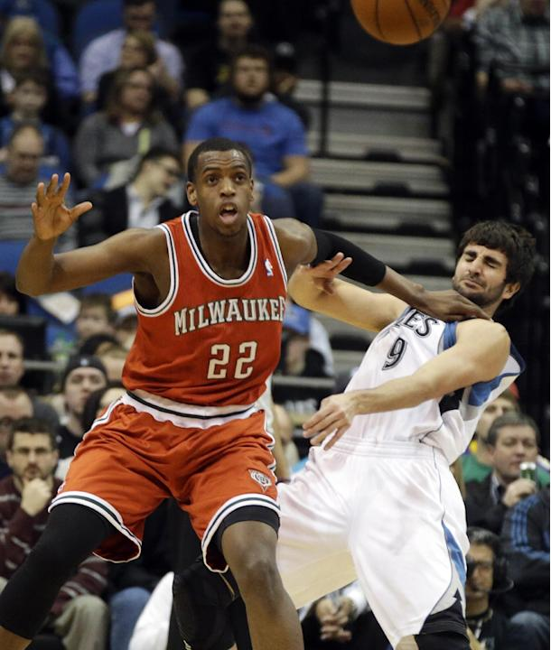 Milwaukee Bucks' Khris Middleton, left, shoves Minnesota Timberwolves' Ricky Rubio of Spain as he waits for a pass in the first quarter of an NBA basketball game, Tuesday, March 11, 2014, in M