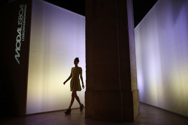A model presents a creation by fashion house White Tent at the Lisbon Fashion Week