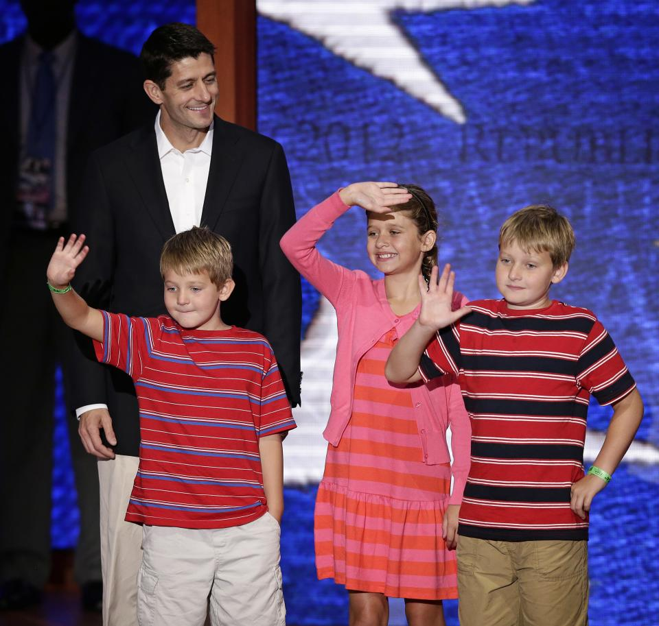 Republican vice presidential nominee, Rep. Paul Ryan of Wisconsin walks across the stage with sons Sam, left, Charlie, right, and daughter Liza during a podium sound check at the Republican National Convention in Tampa, Fla., on Wednesday, Aug. 29, 2012. (AP Photo/J. Scott Applewhite)