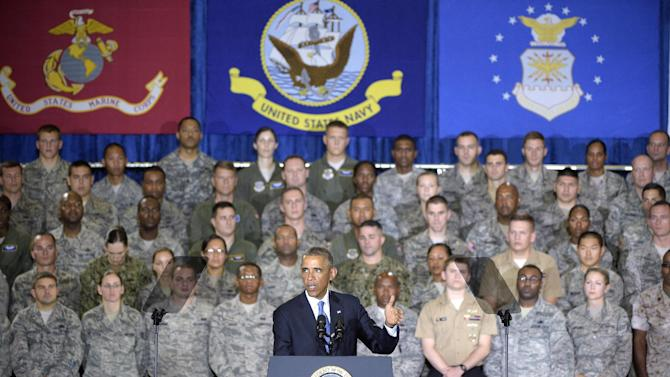 President Barack Obama speaks to a crowd of military personnel at U.S. Central Command at MacDill Air Force Base in Tampa, Fla., Wednesday, Sept. 17, 2014. The White House and the Pentagon are grappling with how to explain what American military forces are doing and could do in Iraq as they battle the Islamic State militants. Obama reiterated his pledge to keep American troops out of combat missions. But hours later, Vice President Joe Biden appeared to be less certain about ground troops. Biden's remarks echoed comments a day earlier from Army Gen. Martin Dempsey, the Joint Chiefs chairman, who said he may, if necessary, recommend to the president that U.S. ground forces accompany Iraqi troops on attacks against Islamic State targets, particularly in certain complex missions or if there were threats to the U.S.(AP Photo/Phelan M. Ebenhack)