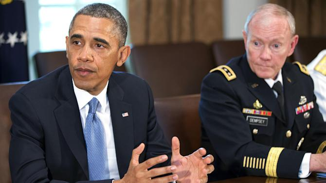 President Barack Obama speaks during a meeting with Joint Chiefs Chairman Gen. Martin Dempsey, left, Defense Secretary Chuck Hagel, and the service secretaries, service chiefs, and senior enlisted advisers to discuss sexual assault in the military in the Cabinet Room of the White House in Washington, Thursday, May 16, 2013. (AP Photo/Jacquelyn Martin)