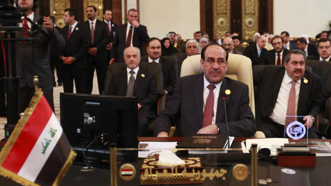 Iraqi Prime Minister Nouri al-Maliki, center, attends the Arab League summit in Baghdad, Iraq, Thursday, March, 29, 2012. The annual Arab summit meeting opened in the Iraqi capital Baghdad on Thursday with only 10 of the leaders of the 22-member Arab League in attendance and amid a growing rift between Arab countries over how far they should go to end the one-year conflict in Syria. (AP Photo/Karim Kadim)