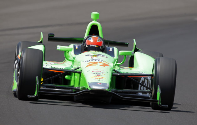 IndyCar driver James Hinchcliffe, of Canada, drives through the first turn on his qualification run on the first day of qualifications for the Indianapolis 500 auto race at the Indianapolis Motor Speedway in Indianapolis, Saturday, May 19, 2012. (AP Photo/Tom Strattman)
